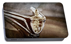 Portable Battery Charger featuring the photograph 1956 Lincoln Premiere Convertible Hood Ornament -2797ac by Jill Reger