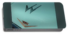 Portable Battery Charger featuring the photograph 1957 Cadillac Twin Fin Hood Ornament by Chris Flees