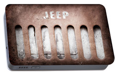 Portable Battery Charger featuring the photograph 1957 Jeep Emblem -0597ac by Jill Reger