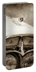 Portable Battery Charger featuring the photograph 1957 Mercury Turnpike Cruiser Emblem -0749s by Jill Reger