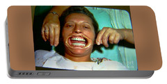 Portable Battery Charger featuring the photograph 1960s Dental Exam by Peter Gumaer Ogden