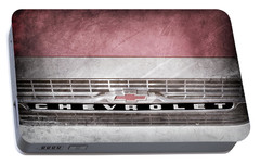 Portable Battery Charger featuring the photograph 1961 Chevrolet Corvair Pickup Truck Grille Emblem -0130ac by Jill Reger