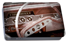 Portable Battery Charger featuring the photograph 1961 Chevrolet Impala Ss Steering Wheel Emblem -1156ac by Jill Reger