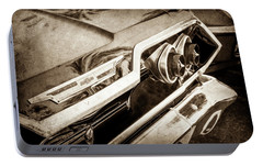 Portable Battery Charger featuring the photograph 1963 Chevrolet Taillight Emblem -0183s by Jill Reger