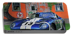 Portable Battery Charger featuring the photograph 1964 Cobra Daytona Coupe by Christopher McKenzie
