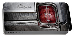Portable Battery Charger featuring the photograph 1965 Oldsmobile Starfire Taillight Emblem -0212ac by Jill Reger