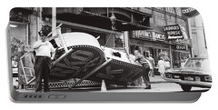 Portable Battery Charger featuring the photograph 1965 Removing Rko Theater Sign Boston by Historic Image