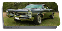 Portable Battery Charger featuring the photograph 1966 Black Gto by Daniel Adams
