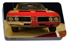 Portable Battery Charger featuring the photograph 1969 Oldsmobile 442 W-30 by Chris Flees