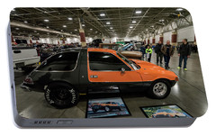 Portable Battery Charger featuring the photograph 1975 Amc Pacer by Randy Scherkenbach