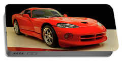 Portable Battery Charger featuring the digital art 1997 Dodge Viper Gts Red by Chris Flees