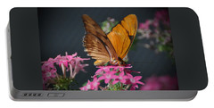 Portable Battery Charger featuring the photograph Butterfly by Savannah Gibbs