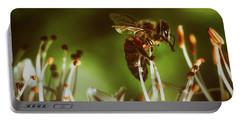 Portable Battery Charger featuring the photograph Bzzz by Michael Siebert