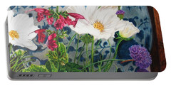 Portable Battery Charger featuring the painting Cosmos by Karen Ilari
