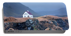 House On Ocean Cliff In Iceland Portable Battery Charger