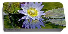 Purple Water Lily Pond Portable Battery Charger by Carol F Austin