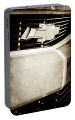 Portable Battery Charger featuring the photograph 2011 Chevrolet Camaro Grille Emblem -0321s by Jill Reger