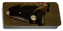 2012 Shelby Cobra 50th Anniversary  Portable Battery Charger by Chris Flees