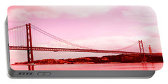 Portable Battery Charger featuring the photograph 25 De Abril Bridge In Crimson by Lorraine Devon Wilke