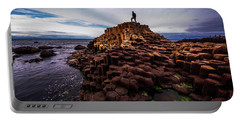 Man Atop Giant's Causeway Portable Battery Charger
