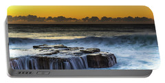 Sunrise Seascape With Cascades Over The Rock Ledge Portable Battery Charger