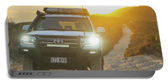4wd Car Explores Sand Track In Early Morning Light Portable Battery Charger