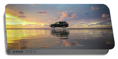 4wd Vehicle And Stunning Sunset Reflections On Beach Portable Battery Charger