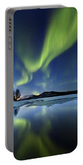 Portable Battery Charger featuring the photograph Aurora Borealis Over Sandvannet Lake by Arild Heitmann