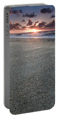 A Beach During Sunset With Glowing Sky Portable Battery Charger