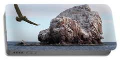 A Brown Pelican Does A Flyby Of A Guano Covered Desert Island  Portable Battery Charger