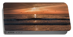 Portable Battery Charger featuring the photograph A Burnished Sunrise by John M Bailey