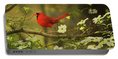 A Cardinal And His Dogwood Portable Battery Charger by Darren Fisher