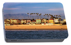 Portable Battery Charger featuring the photograph A Clear Day At The Beach by James Eddy