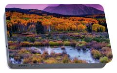 Portable Battery Charger featuring the photograph A Colorado Fall Along Kebler Pass by John De Bord