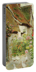A Cottage Door Portable Battery Charger