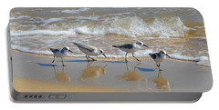 A Cute Quartet Of Sandpipers Portable Battery Charger