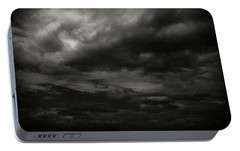 Portable Battery Charger featuring the photograph A Dark Moody Storm by John Norman Stewart