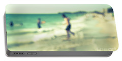 a day at the beach III Portable Battery Charger by Hannes Cmarits