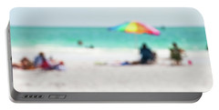 a day at the beach IV Portable Battery Charger by Hannes Cmarits