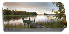 A Dock On A Lake At Sunrise Near Wawa Portable Battery Charger