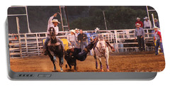 Portable Battery Charger featuring the photograph A Dusty Rodeo Challenge by Natalie Ortiz
