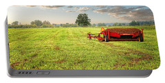 Portable Battery Charger featuring the photograph A Field At Sunrise by Lars Lentz