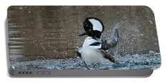 Portable Battery Charger featuring the photograph A Flurry Of Feathers by Fraida Gutovich