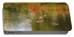 A Gaggle Of Geese Portable Battery Charger by Cedric Hampton