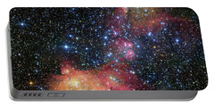 Portable Battery Charger featuring the photograph A Glowing Gas Cloud In The Large Magellanic Cloud by Eso