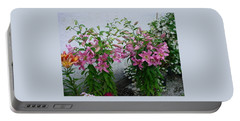 Portable Battery Charger featuring the photograph A Lily Bouquet by Jay Milo