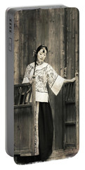 A Model In A Period Costume. Portable Battery Charger