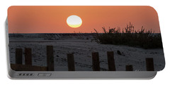 Portable Battery Charger featuring the photograph A November Sunset Scene by Arik Baltinester