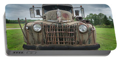 Portable Battery Charger featuring the photograph A Really Rusty Ford by Guy Whiteley