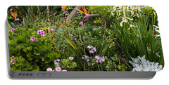 Portable Battery Charger featuring the photograph A Riot Of Flowers by Lorraine Devon Wilke